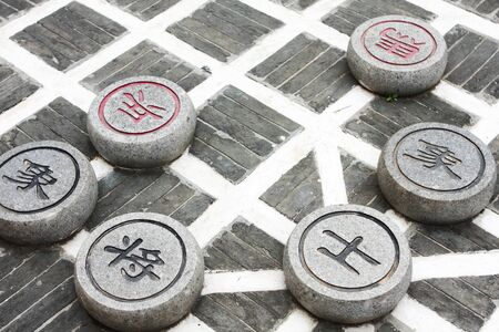 stone chinese chess in the park close up photo