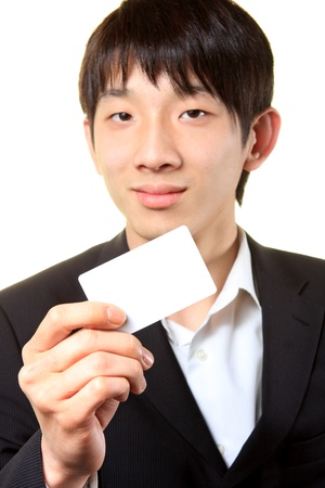 businessman with empty card in hand  photo