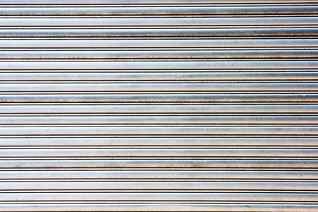 shutter: worn metal garage door gate store roller shutter
