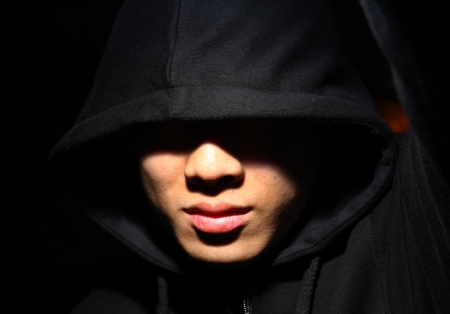 Monochrome picture of a guy in a hood Stock Photo - 9138462