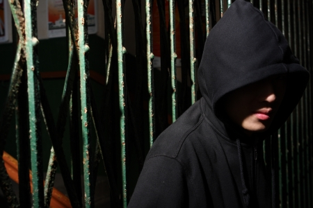 man in hood at night, want to break the shutter Stock Photo - 9138461