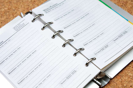 schedule book on wood board photo