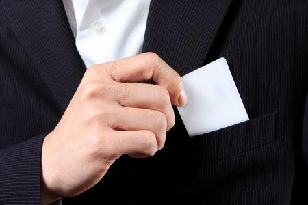 Businessman Holding a Card out of his suit pocket Stock Photo - 9327153
