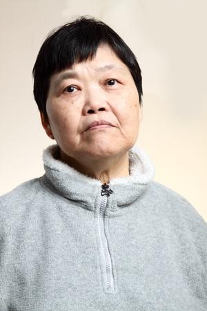 sad old woman: 60s Senior Asian Woman  Stock Photo