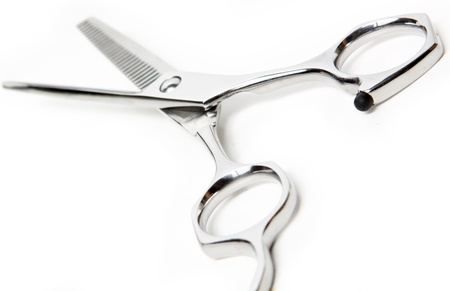 haircutting: Professional Haircutting Scissors. Studio isolation on white.  Stock Photo
