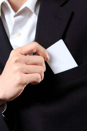 hands in pockets: Businessman Holding a Card out of his suit pocket