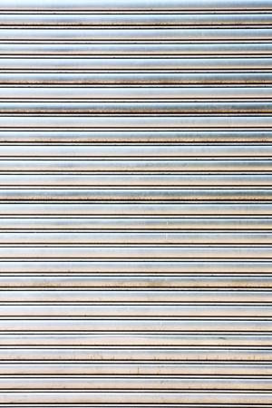 worn metal garage door gate store roller shutter  photo