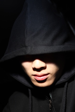 Monochrome picture of a guy in a hood Stock Photo - 9465484