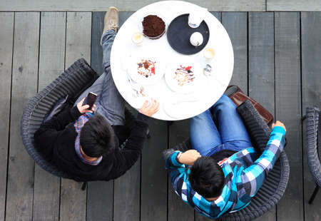 Aerial view of two man talking while having tea photo