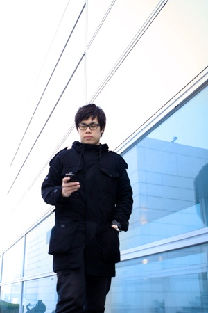 Business man using cellphone when waiting in station.  photo