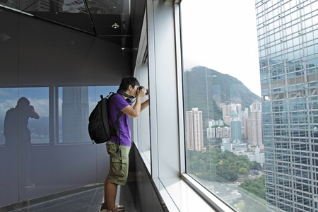 photographer takes a photo of the landscape indoor photo