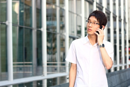 businessman talks with a mobile phone  photo