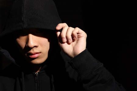 Monochrome picture of a guy in a hood  Stock Photo - 10017528