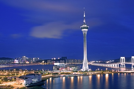 macau: Urban landscape of Macau with famous traveling tower under sky near river in Macao, Asia. Editorial