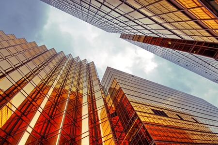 office building exterior: Skyscrapers with clouds reflection