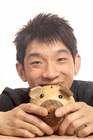 asia man with piggy bank  photo