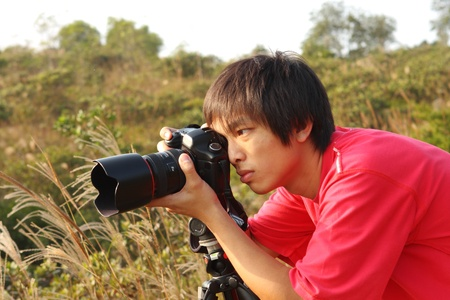 photographer taking photo in country side  photo
