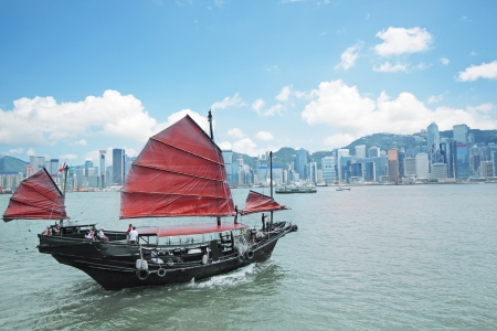 kowloon: Junk boat with tourists in Hong Kong Victoria Harbour Stock Photo
