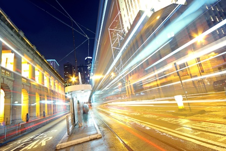 traffic light trails in the street by modern building Stock Photo - 10173310
