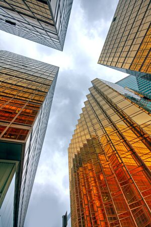 large office: Skyscrapers with clouds reflection