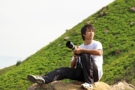 asian man taking photo in hiking photo