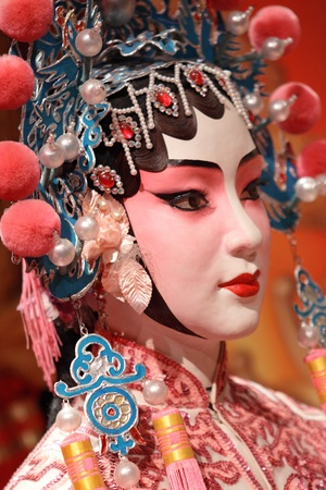 chinese opera dummy and red cloth as text space ,it is a toy,not real man  Stock Photo - 10412806