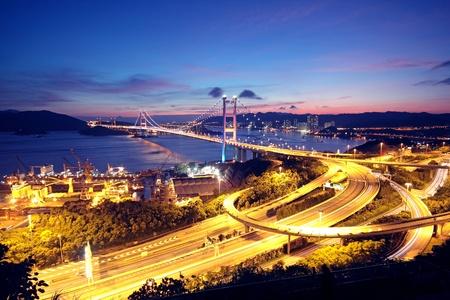 kong river: highway bridge at night in hong kong