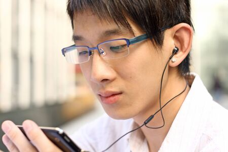 hands free device: Businessman Using a Hands Free Device