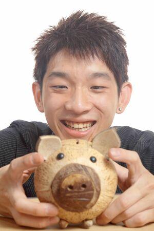 asia man with piggy bank  photo