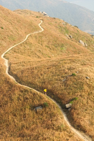 path in mountain, and a man walking photo