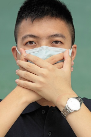 shut: man wear mask and use his hand cover mouth