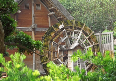 water wheel on old grist mill in forest photo