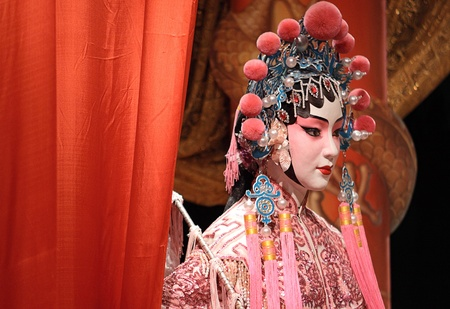 chinese opera: chinese opera dummy and red cloth as text space ,it is a toy,not real man