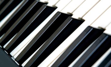 acoustically: piano keyboard close up