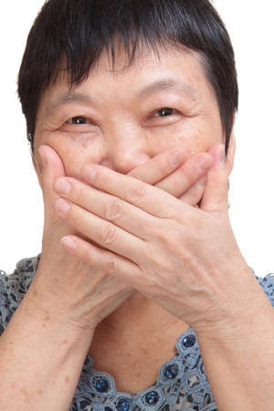old woman covering her mouth