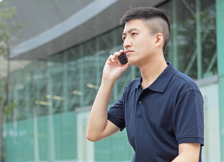 young man talking phone outdoor photo