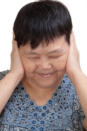 Woman covering her ears - Hear no evil photo