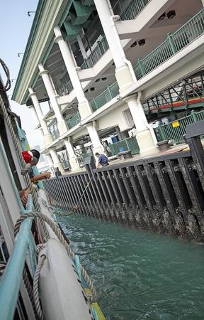 Ferry board pier in hongkong Stock Photo - 10905038