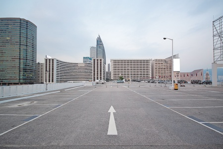 vacant lot: large numbered space parking lot  Stock Photo