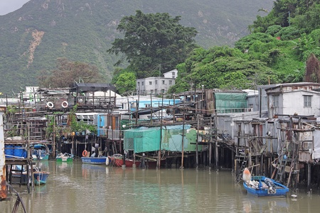 famous wood house on water in hongkong photo