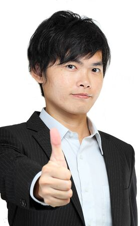 portrait of young man in suit and thumbs up photo