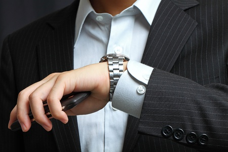 mens hand with a watch.