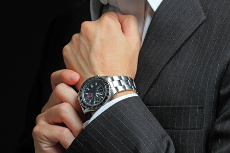 wrist: mens hand with a watch.