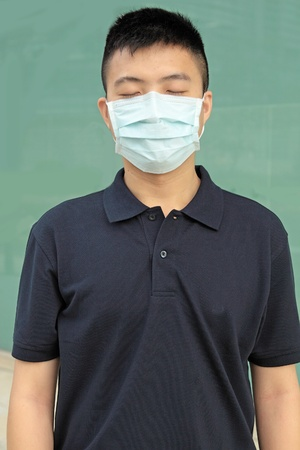 china people: man wear mask outdoor