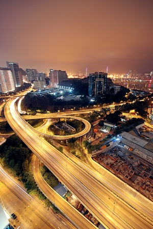 junction: Freeway in night with cars light in modern city.