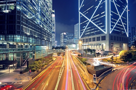 busy street: High speed traffic and blurred light trails  Stock Photo