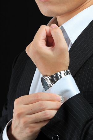 suit  cuff: clasp a cuff  Stock Photo
