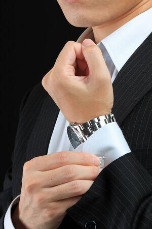 suit  cuff: clasp a cuff  Stock Photo
