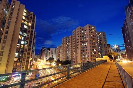 modern urban city at night with freeway traffic photo