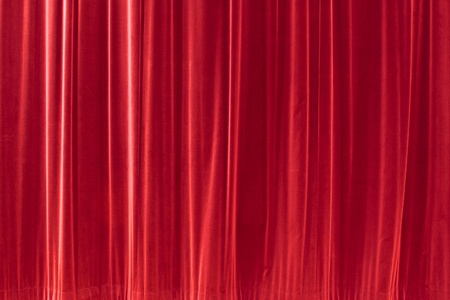 red background texture that looks like a silky fabric or curtain. This tiles seamlessly as a pattern.  photo